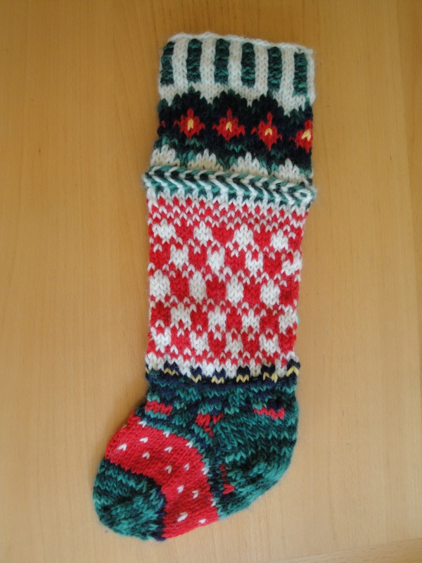 Green toe and heel, red and white patterns in three different combinations, and green, white and red cuff bordered with a green and white braid.